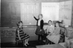 Carol Meynen, Debbie Mason, John Ruthman and Gail Johnson.  Mrs. Howard's first grade class at Rugen.