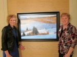3/30/12 Debbie Mason and Mary Barnes at Mary's art exhibit in Wisconsin.  The painting in the photo is a scene from my